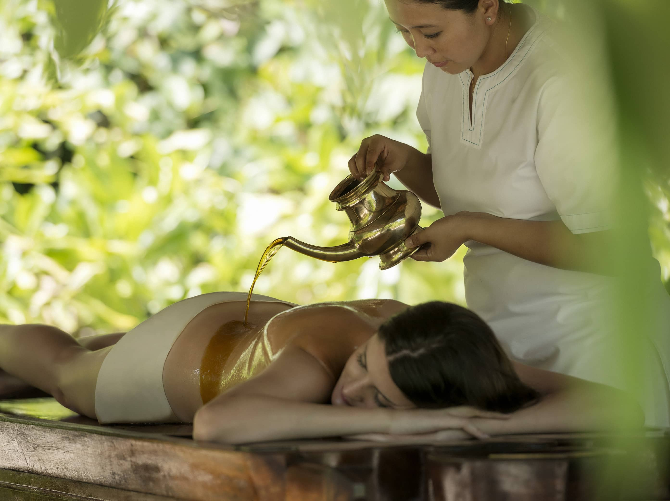 Unwind with a holistic spa treatment in the lush jungle.