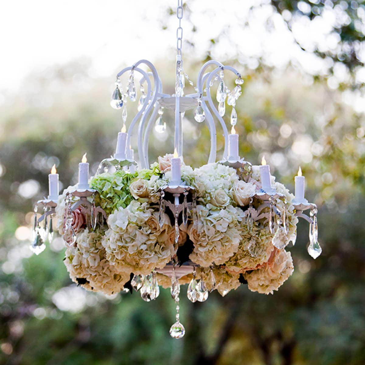 Autumn wedding in austin four seasons hotel austin a floral chandelier sparkles above the couple during the ceremony arubaitofo Images