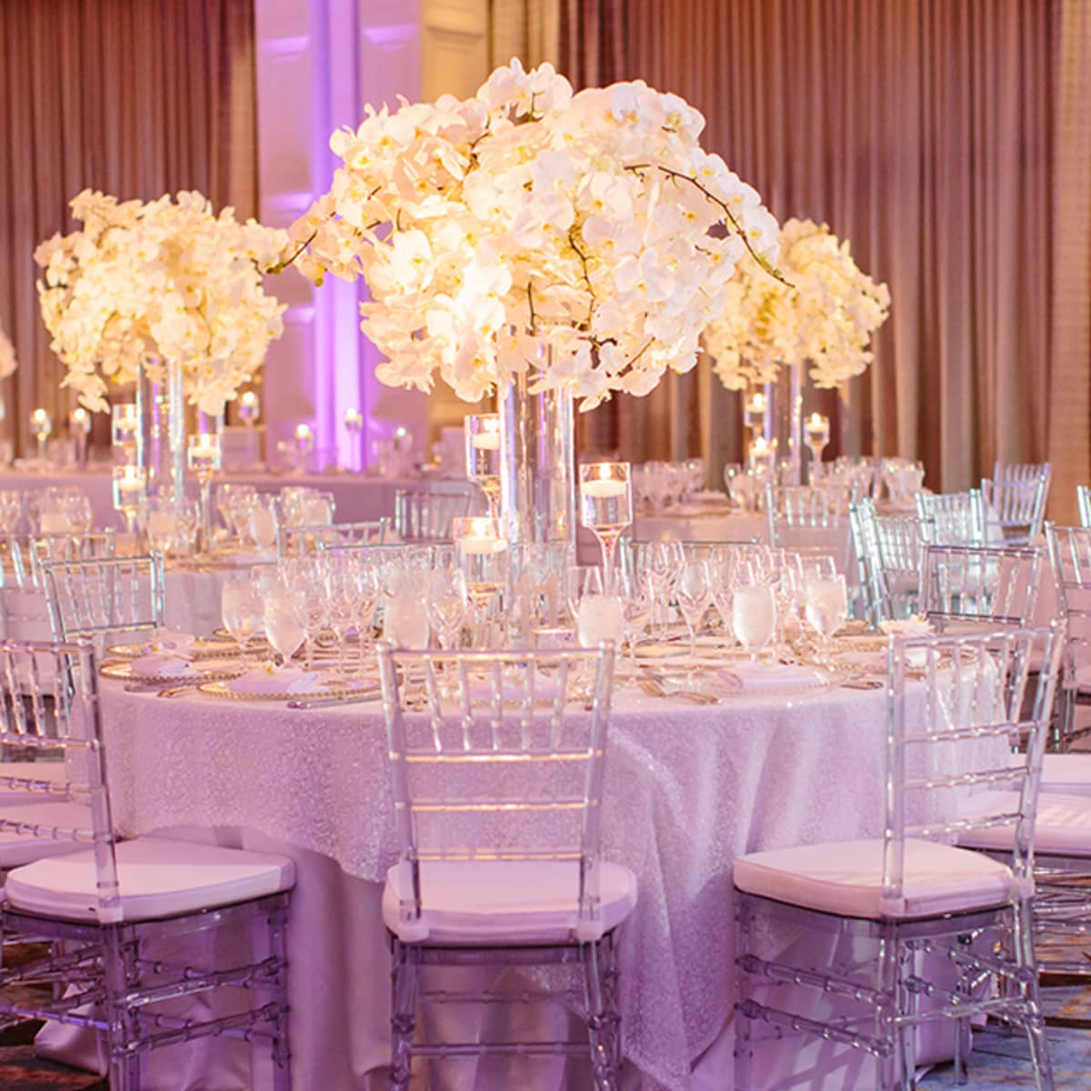 Weddings at disney parks and resorts - White Flowers And Candlelight Enhance The Reception Tables