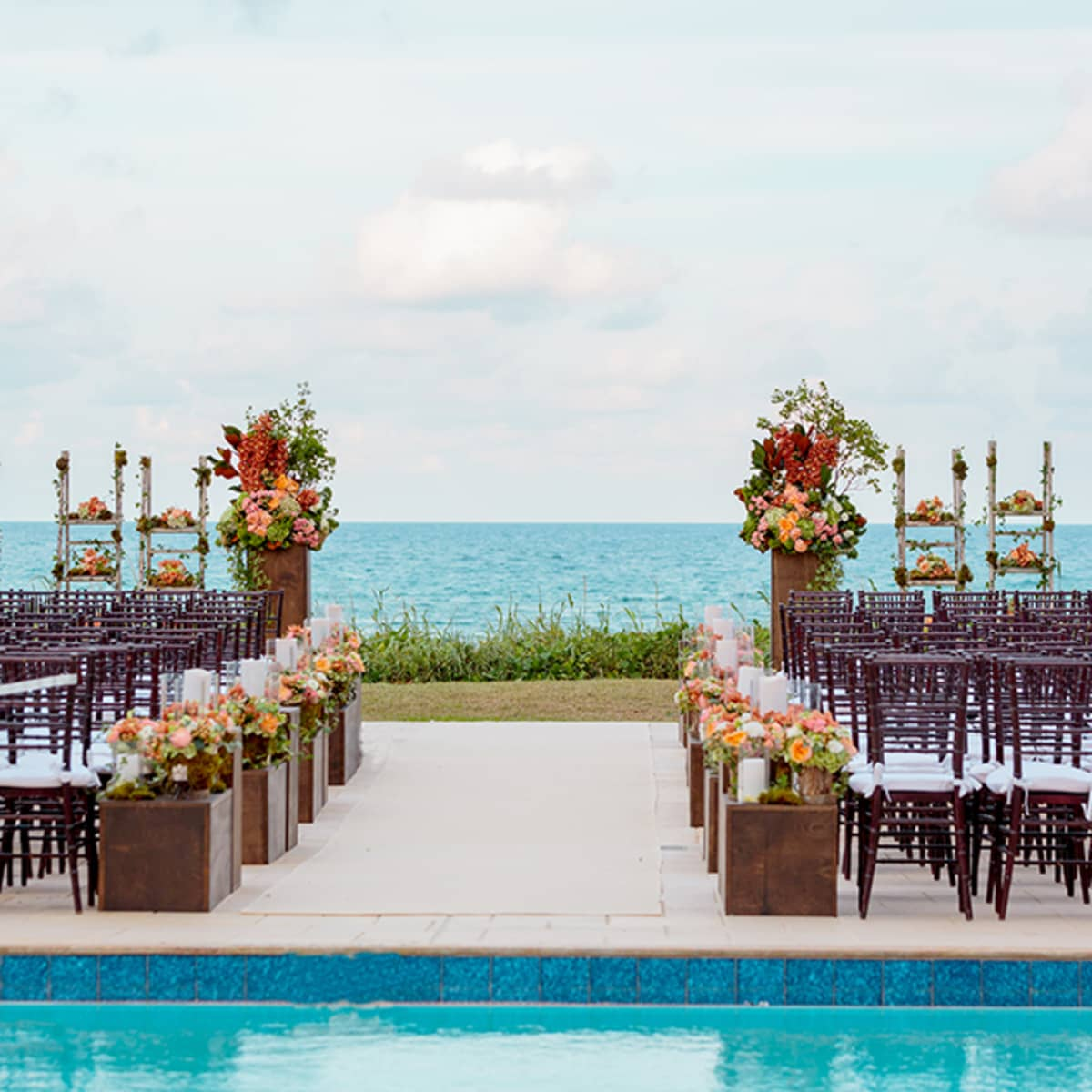 For The Ceremony Oceanfront Setting Is Decorated With Peach Ivory And Green Fls
