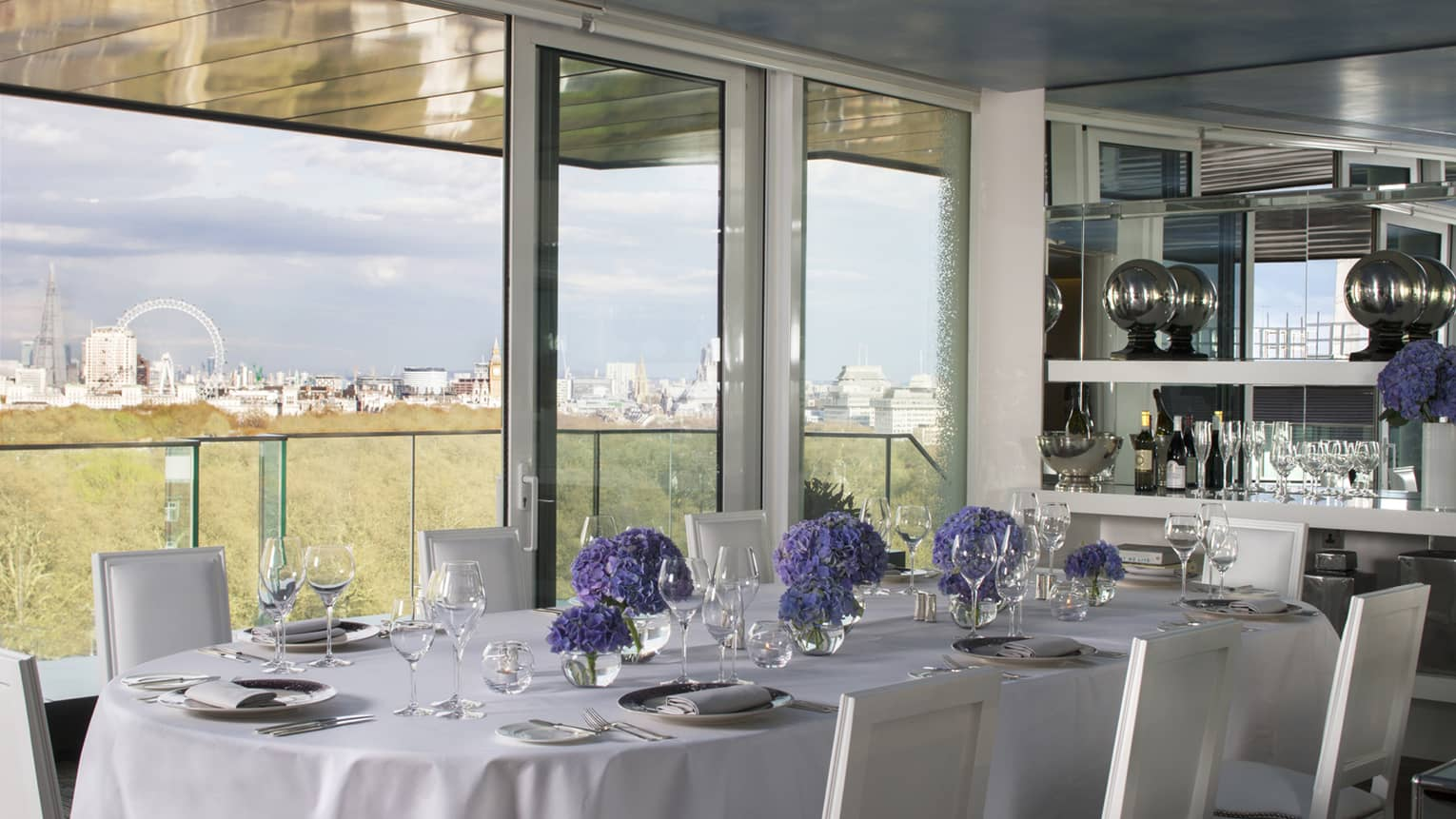 Private dining table along sunny window with London views in Tenth Floor Lounge
