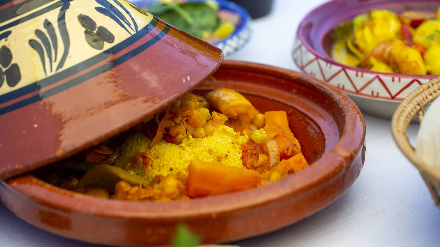 A close up of a vegetable dish in a terracotta plate with cover at Al Barakat