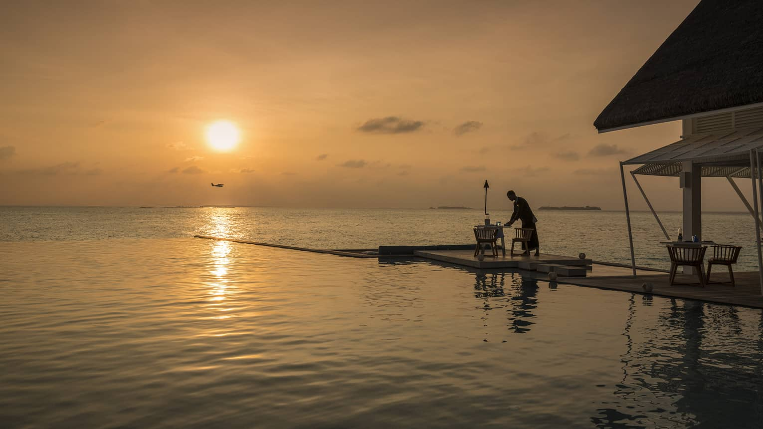 An intimate sunset dinner on a a dock at the Blu Beach Club