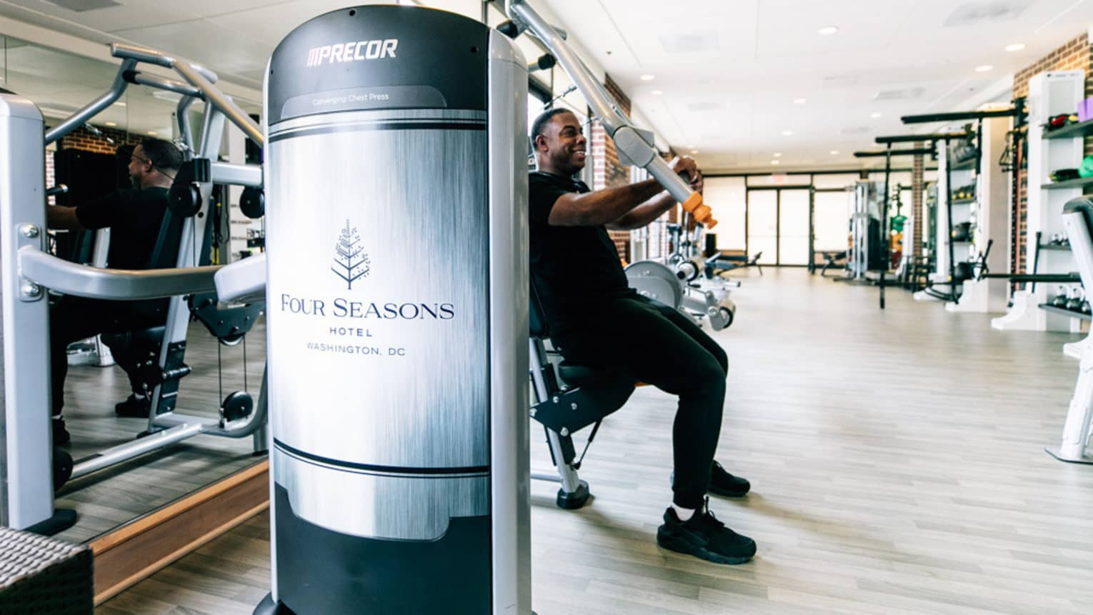 A man uses an arm press at the Four Seasons gym