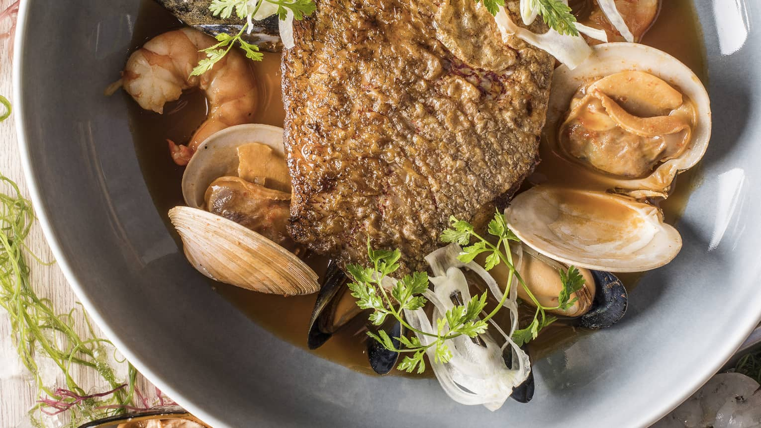 Snapper bouillabaisse with spicy diakon and lemongrass