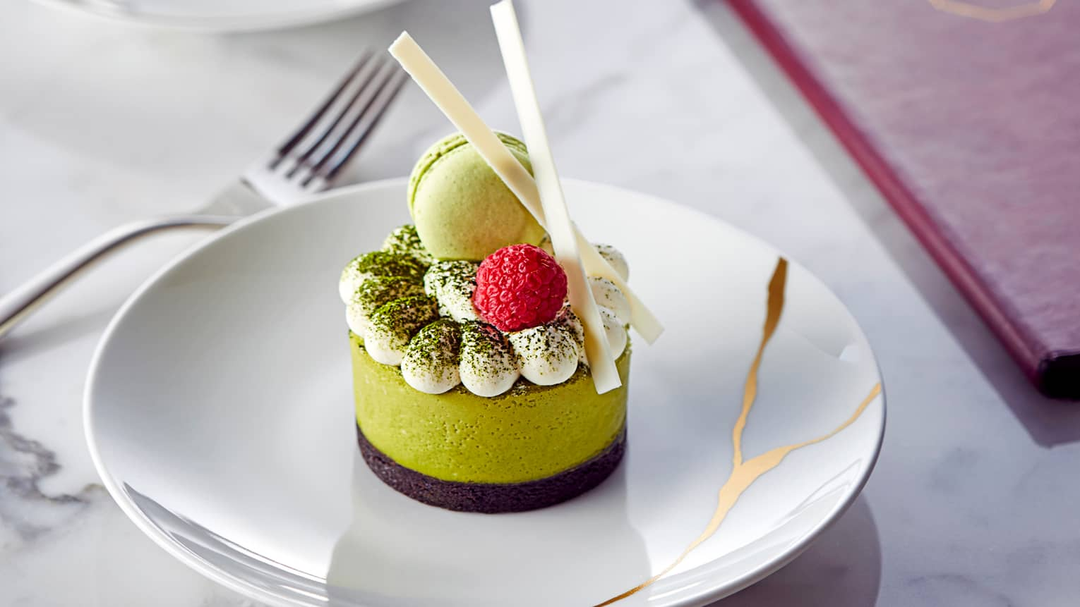 Close-up of green gourmet dessert cake by Maru menu