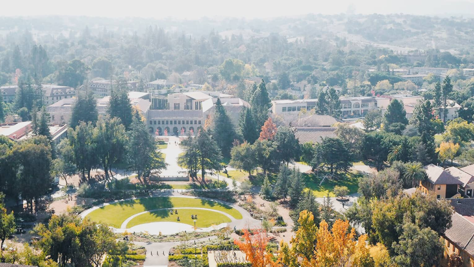 Aerial view over Stanford University campus grounds, buildings on sunny day