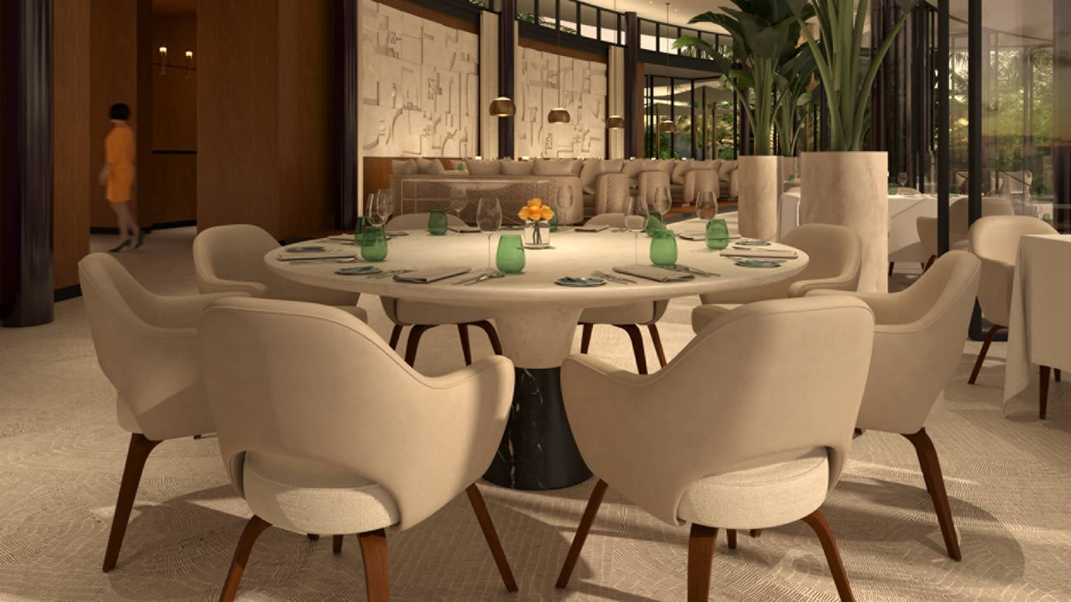Mid-century style white dining chairs line round table under curved modern gold sculpture