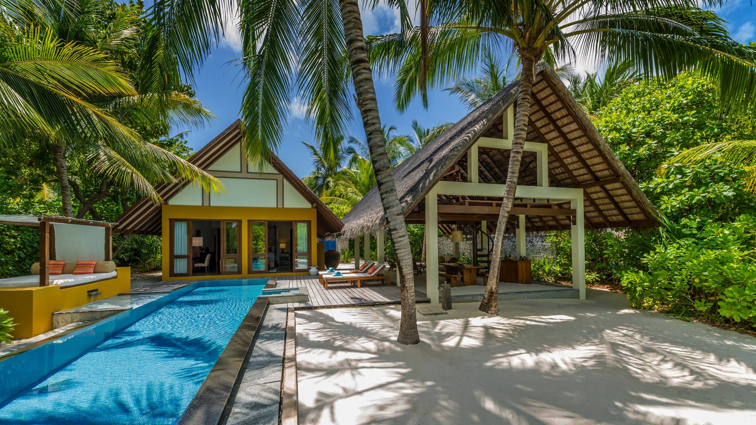 Beach Villa with Pool exterior, outdoor pool by bungalow and thatched roof pavilion
