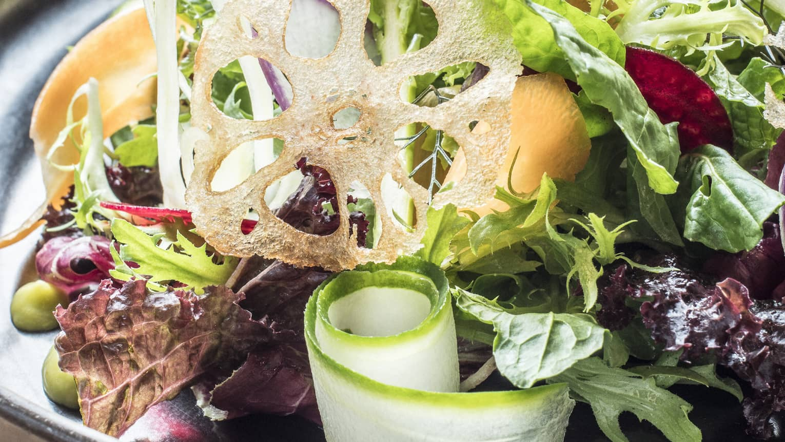The signature organic salad with sweet and our avocado, organic vegetables, sherry vinaigrette and lotus root