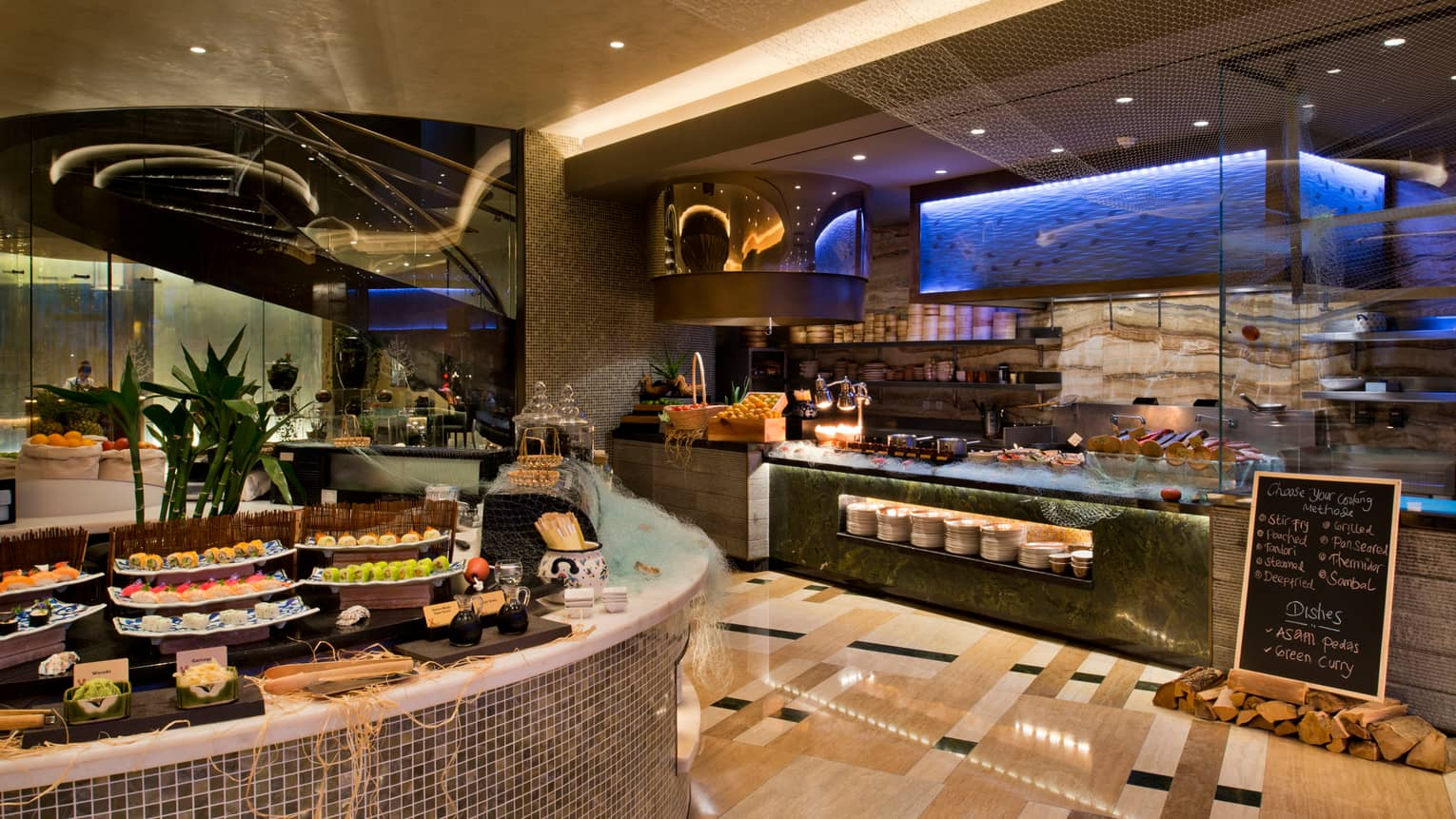 Bahrain Bay Kitchen buffet stations with sushi and seafood bar, sushi rolls on white platters