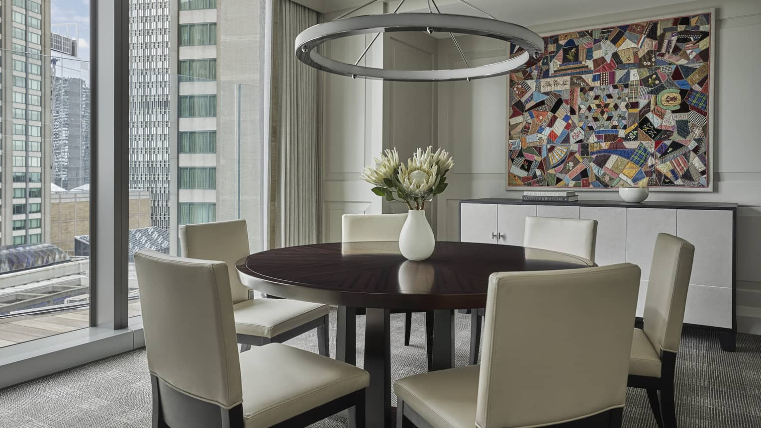 The dining table in a suite overlooks downtown Boston