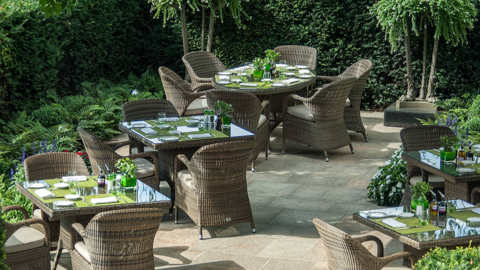 Amaranto restaurant garden patio, large wicker chairs and dining tables