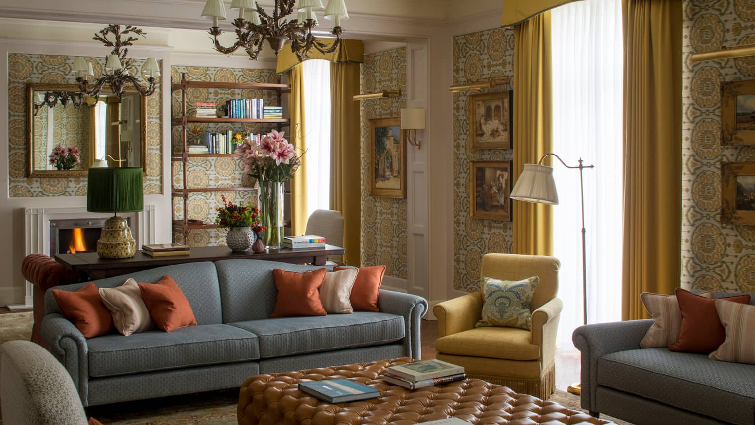 Royal Suite vintage wallpaper, gold-framed paintings, flowers around seating area