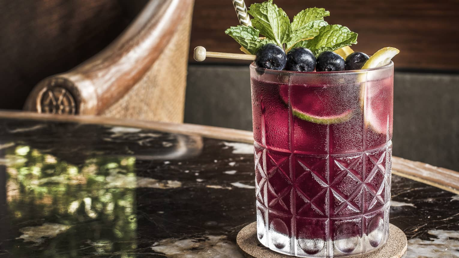 Spanish sangria in a glass with blueberry garnish