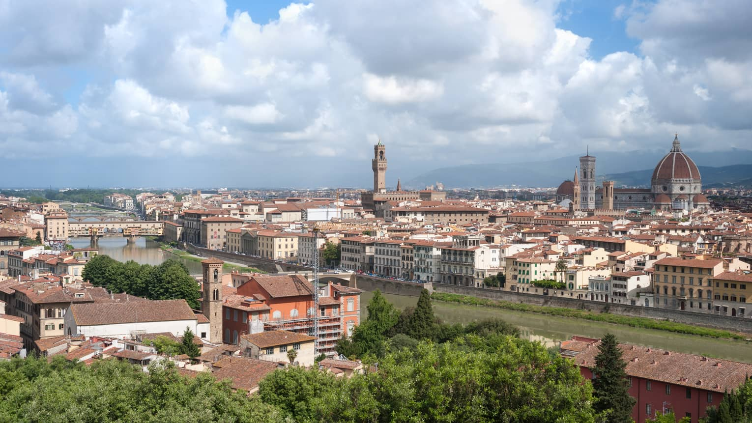 Daytime view over Florence rooftops, houses, cathedrals