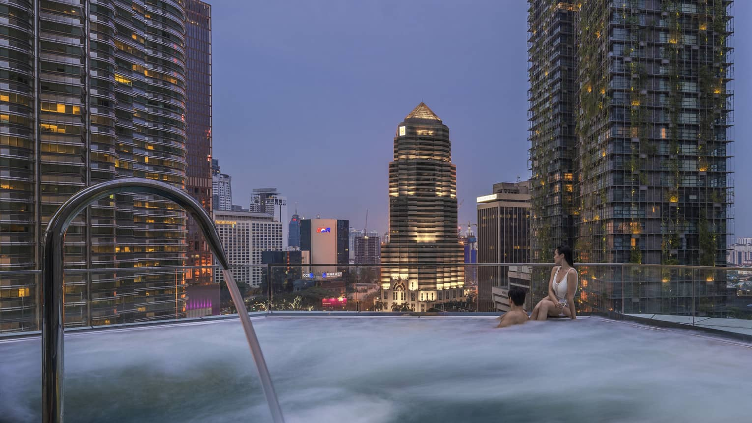 Pool with a view of the city skyline at Four Seasons Hotel Kuala Lumpur
