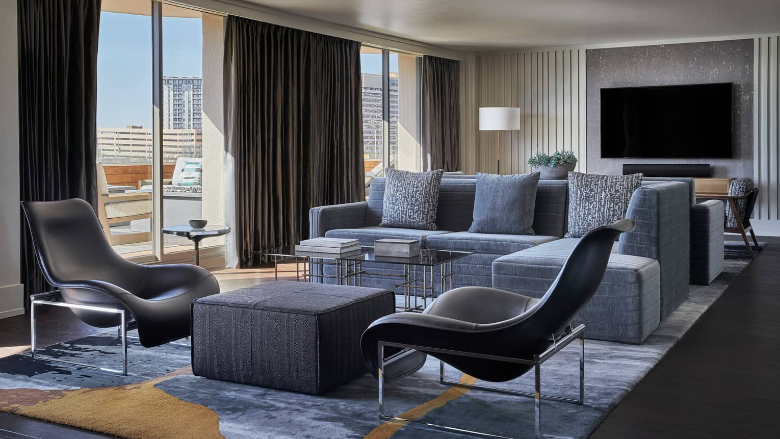 Congressional Suite modern sectional sofa, accent chairs, floor-to-ceiling windows, TV