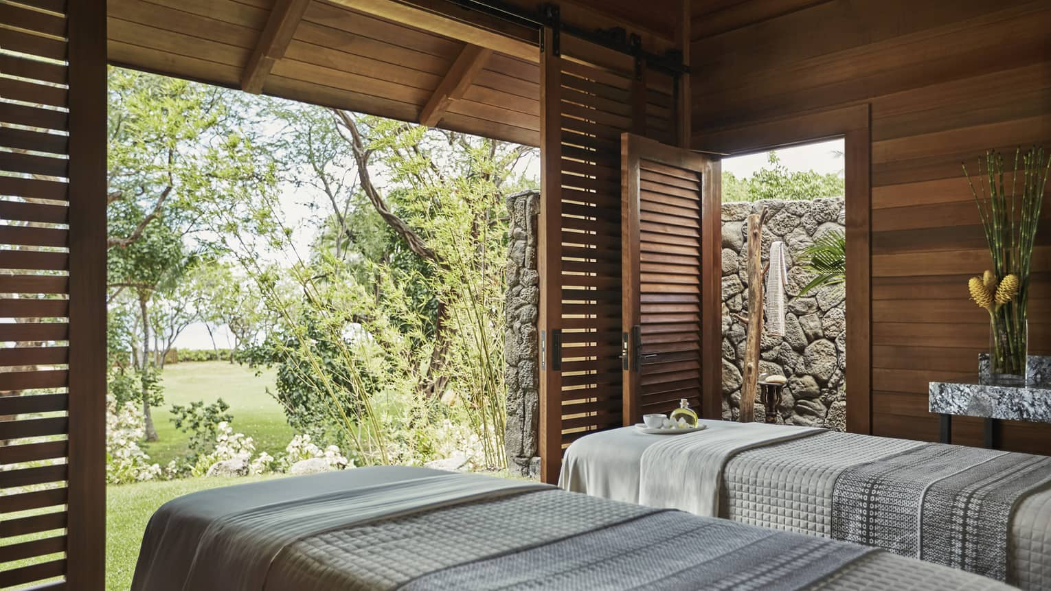 Spa Hale Couples Room side-by-side in pavillions with open sliding wood shutters