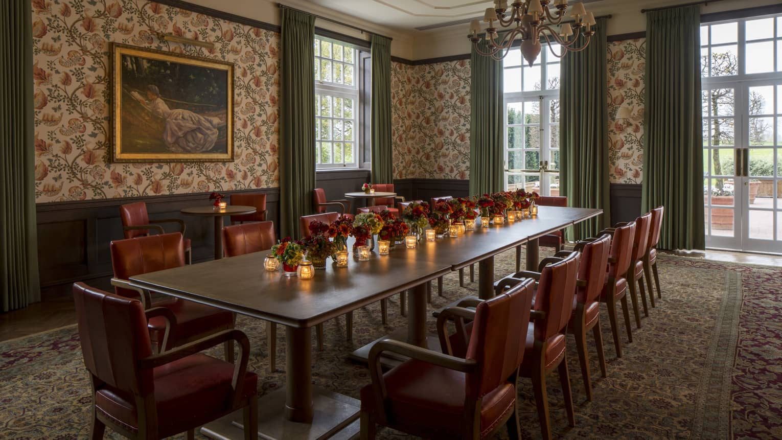 Fox Hollow private dining room, table with candles, red flowers and leather chairs
