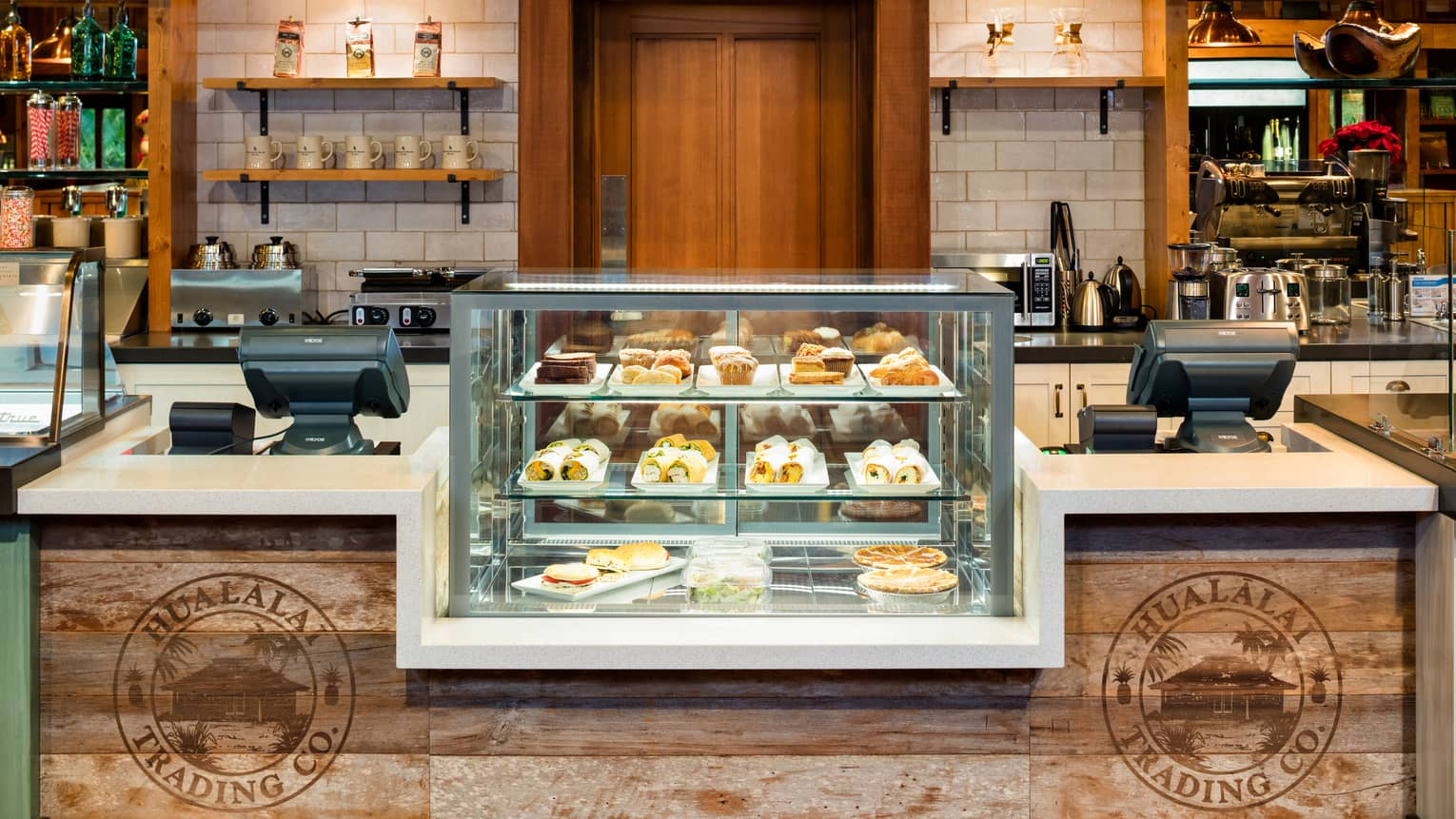 Hualalai Trading Company glass display with desserts at rustic wood counter