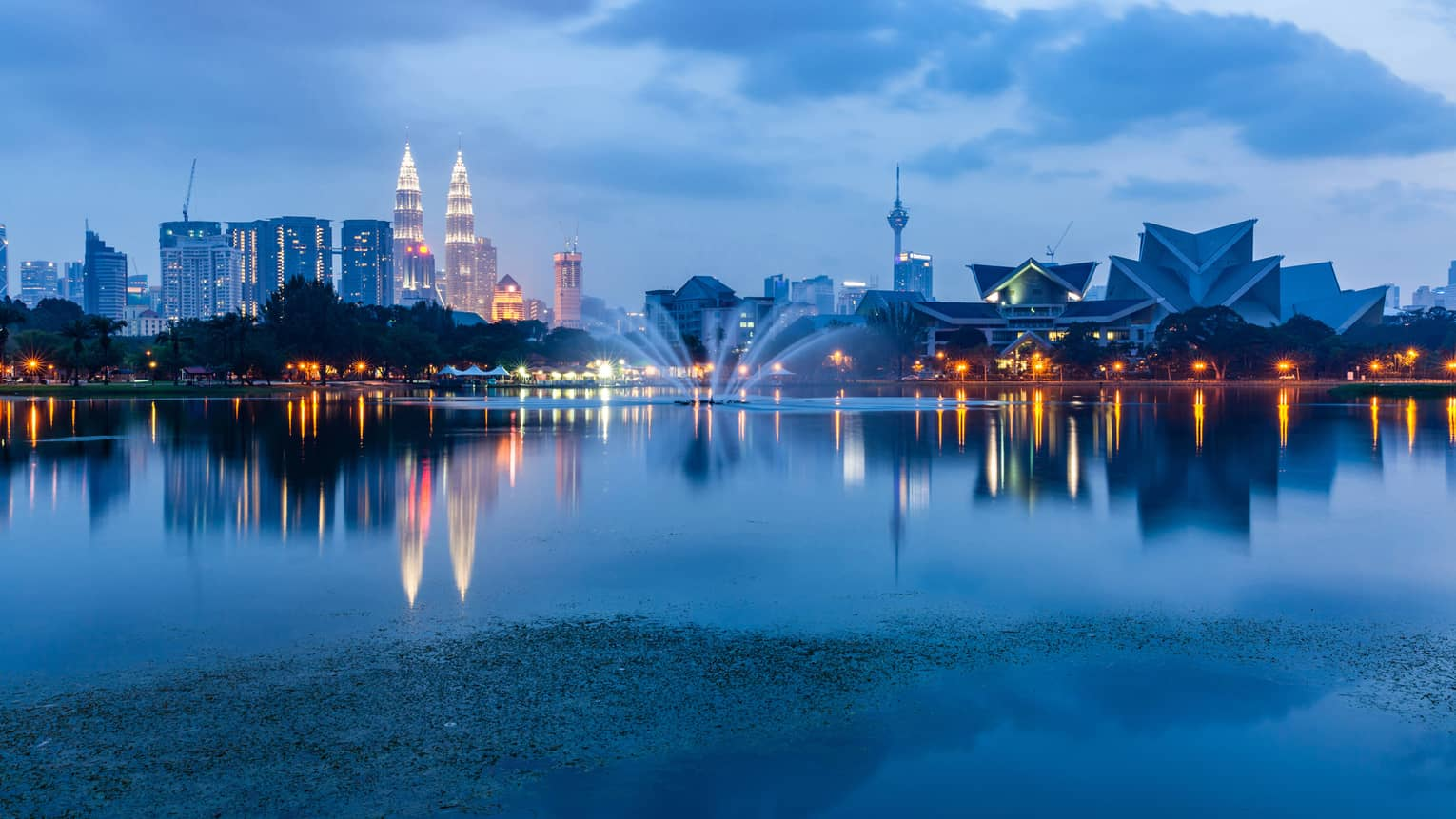 View of the city of Kuala Lumpur at dusk reflecting on the river