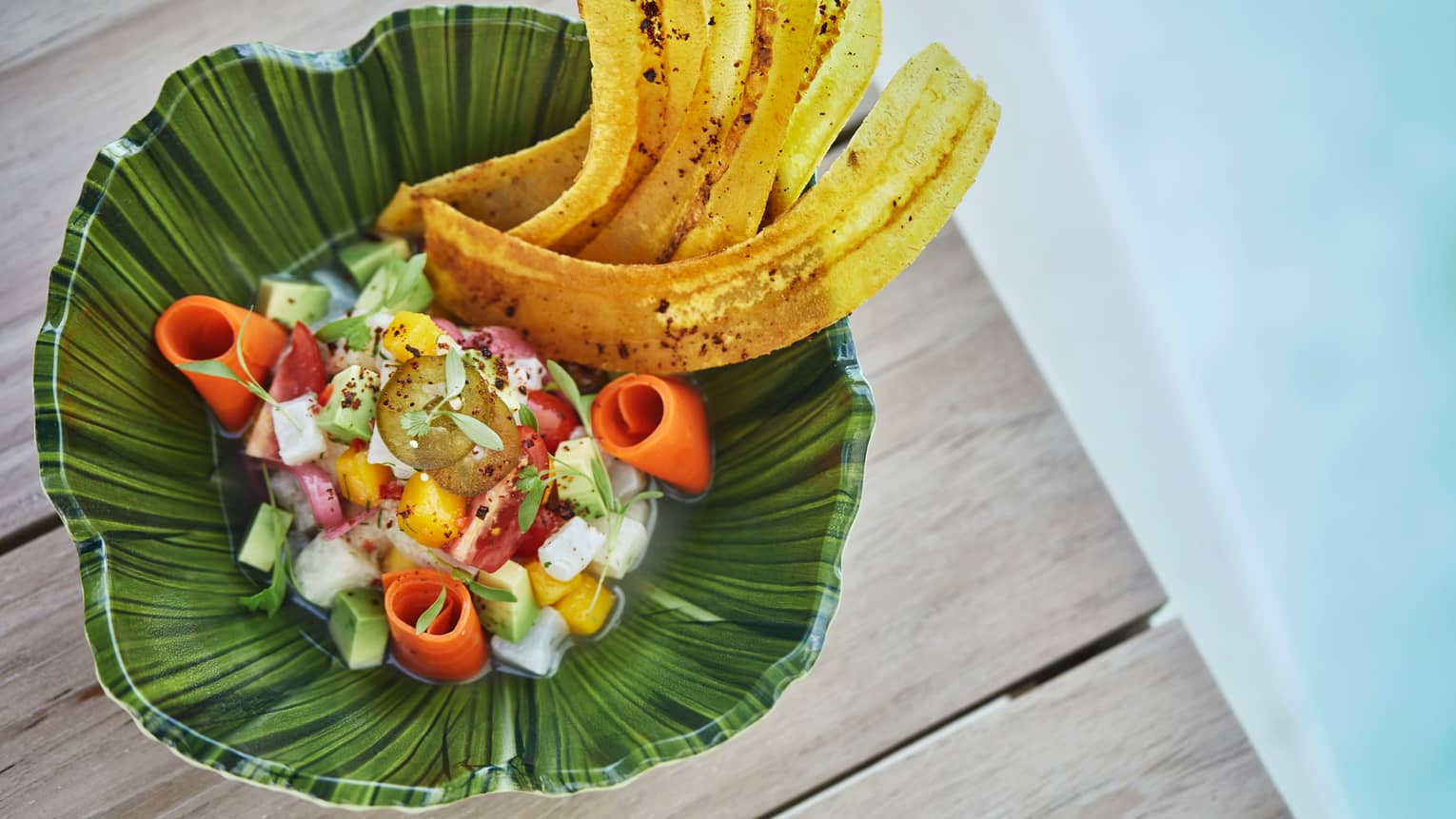 Poolside dining. View of tropical dish snapper ceviche with Florida mango