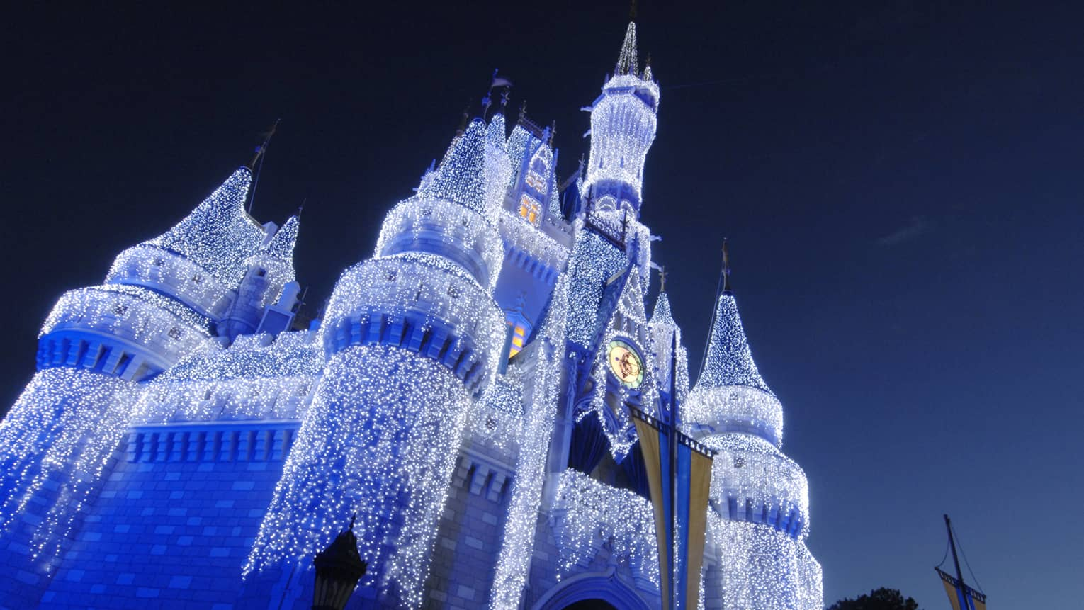 Cinderella's Castle is aglow with bright blue lights
