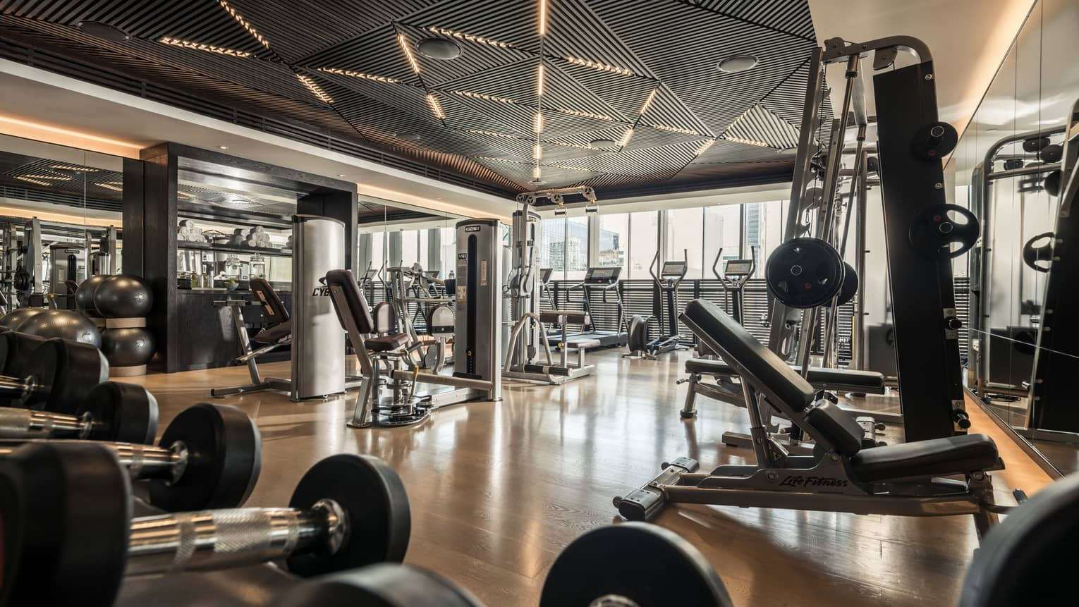 Cardio machines and weight stations line the Fitness Centre