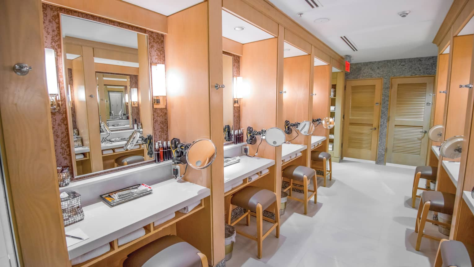 Fitness Centre dressing tables in rows along walls, each with mirrors, shaving mirrors, white towels, stools