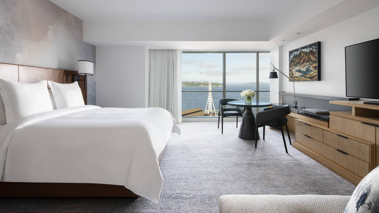 Deluxe Bay-View Rooms offer views of Elliott Bay through floor-to-ceiling windows