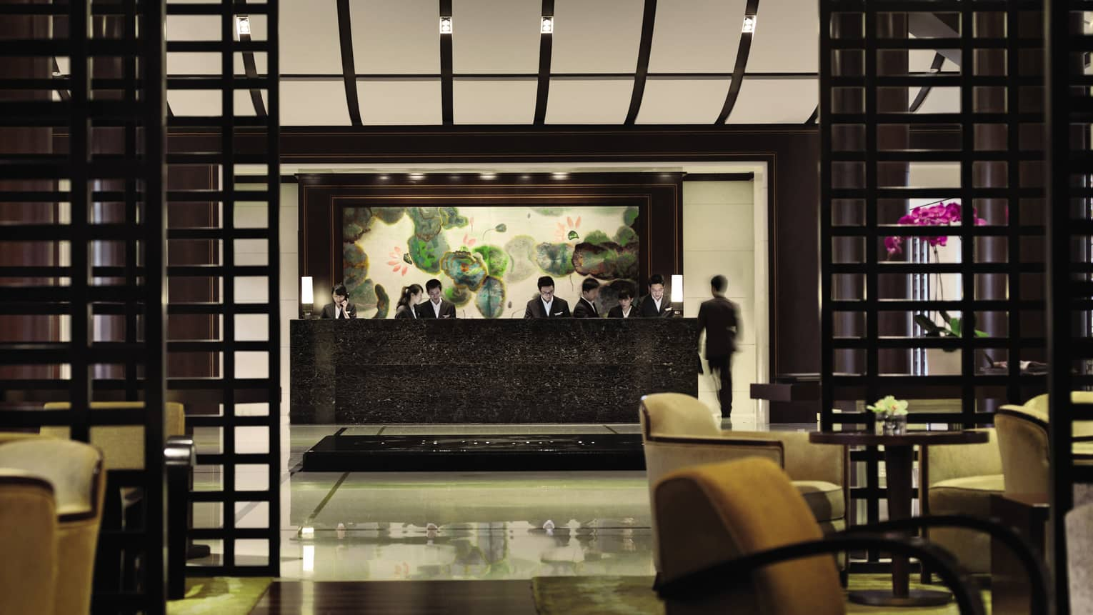 Four Seasons Hotel Hangzhou lobby with black marble reception desk, wood frames