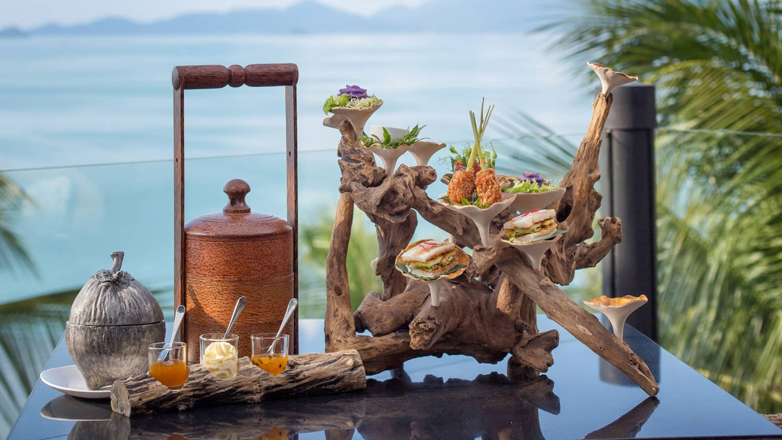 Afternoon tea on a terrace in Koh Samui with a view of the Gulf of Thailand
