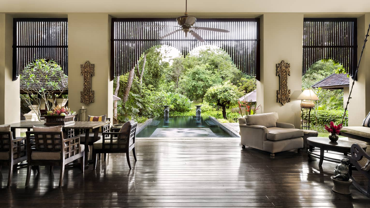 Residence Villa open air living dining room, gleaming wood floors, open wall to pool