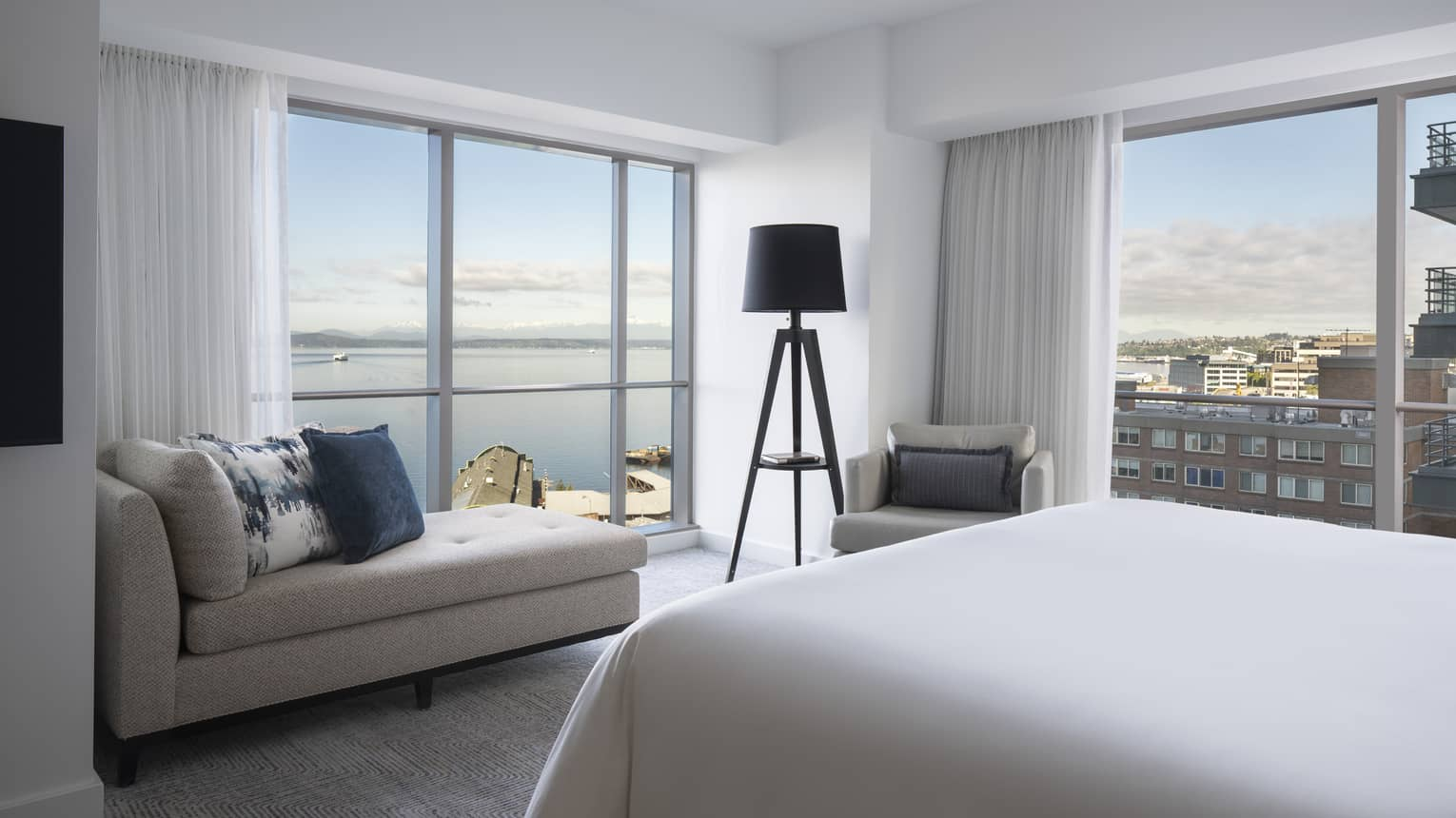 The well-lit Bay Suite overlooks boats sailing along Elliot Bay