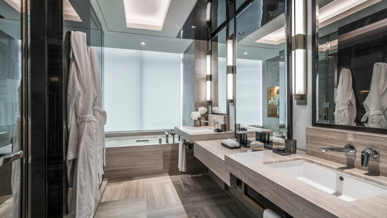 Corner Room Bathroom with robes hanging on the wall