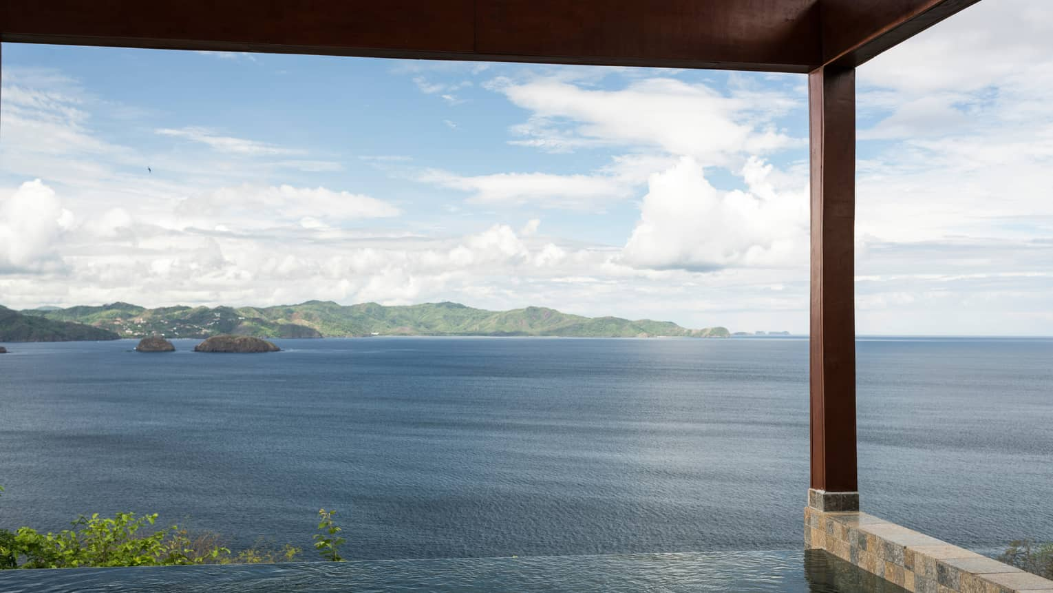 Canopy Plunge Pool Suite with sweeping views of ocean, mountain from edge of private infinity swimming pool