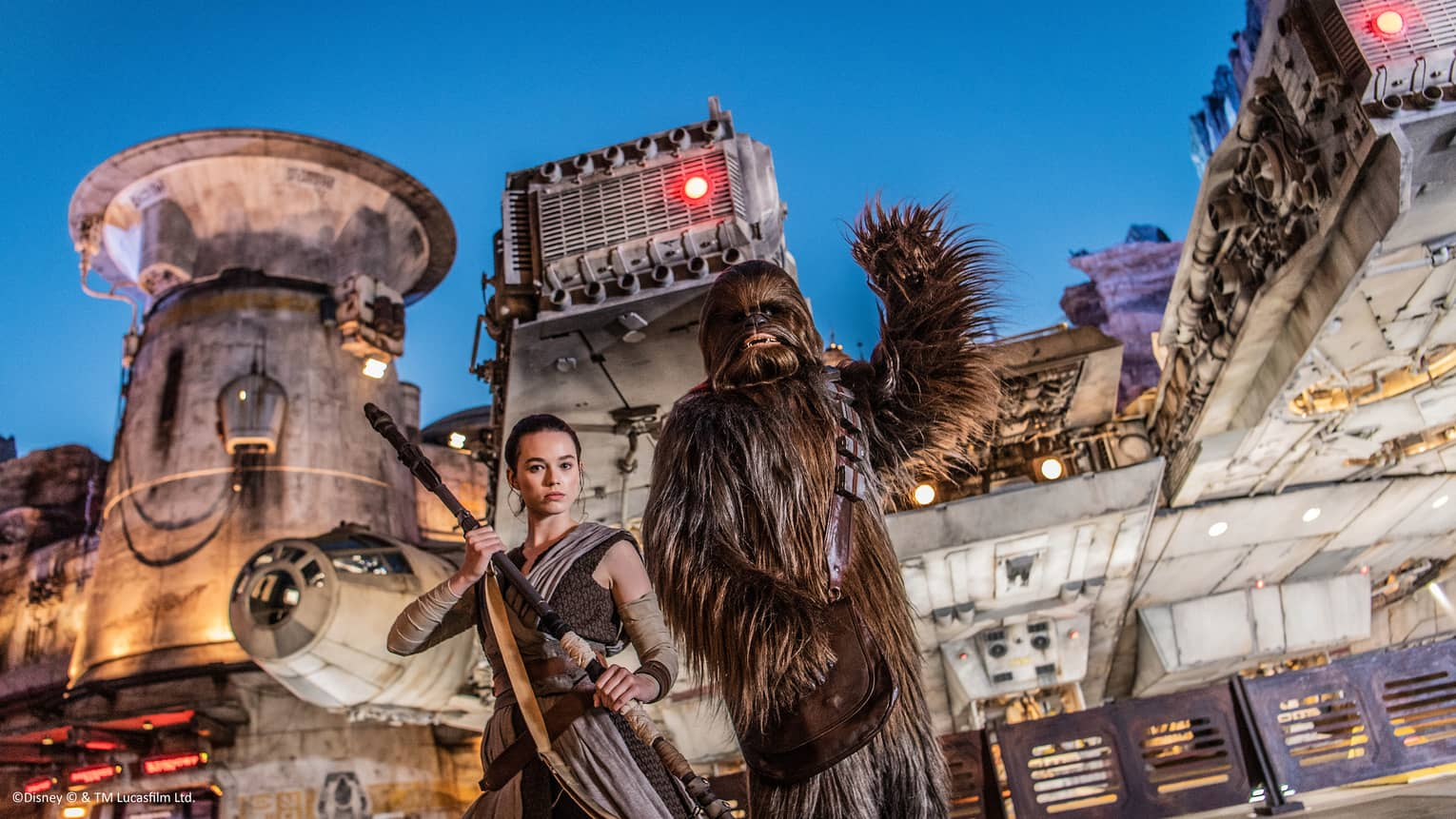 Actors dressed as Rey and Chewbacca greet visitors at Star Wars Galaxy's Edge