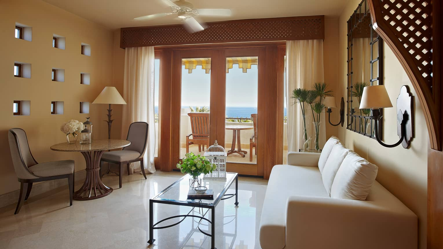 Premier Sea-View Room white sofa, glass coffee table, cafe-style dining table by balcony doors