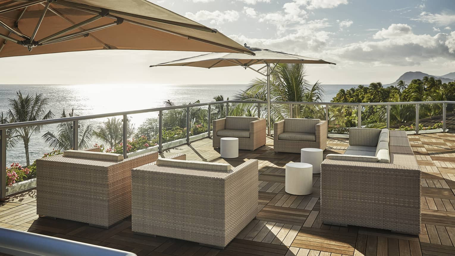 Presidential Suite patio with large wicker chairs, parquet floors, umbrellas, ocean view