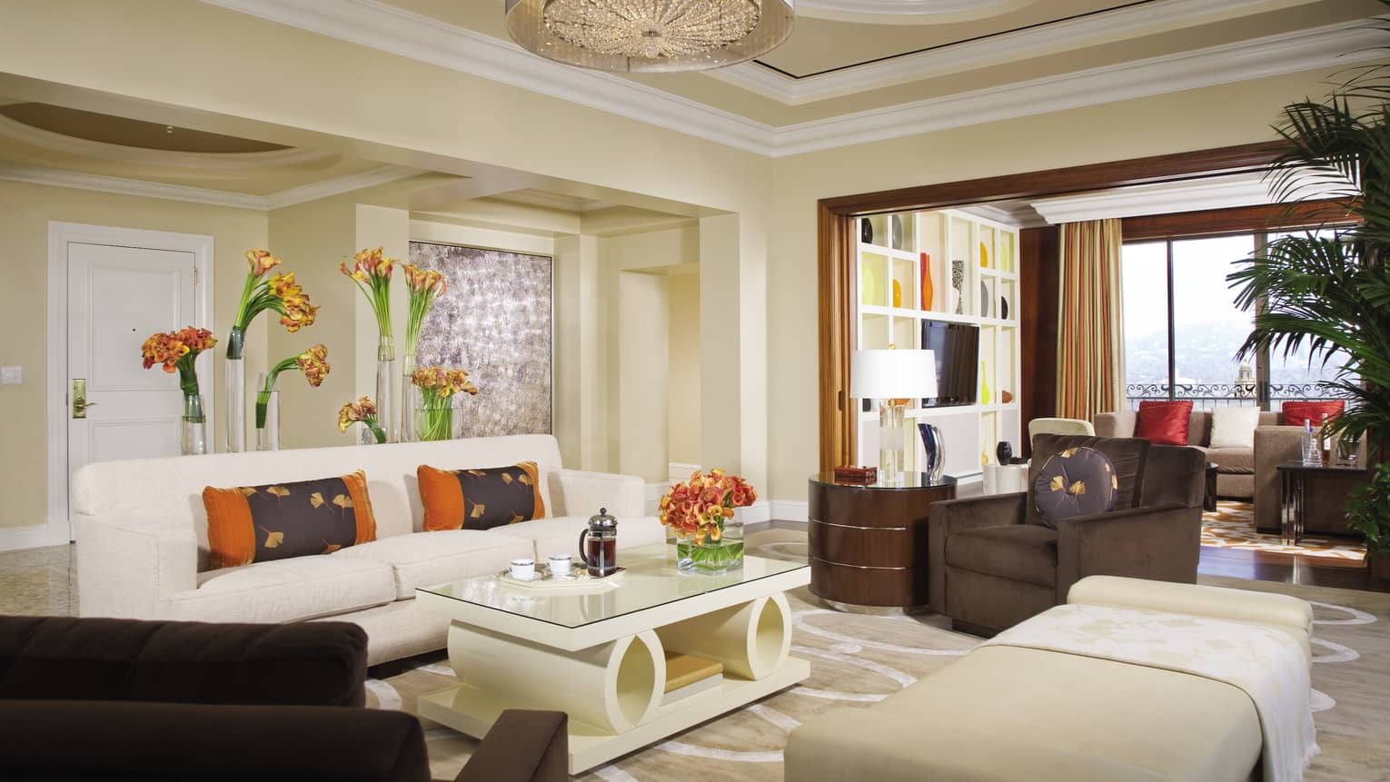 Penthouse Suite white sofa, modern coffee table, chaise, armchair by second seating area