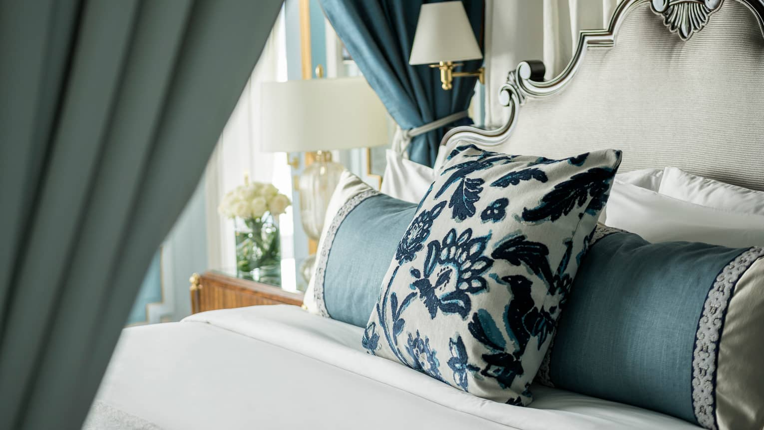 Presidential Suite bed with embroidered pillow