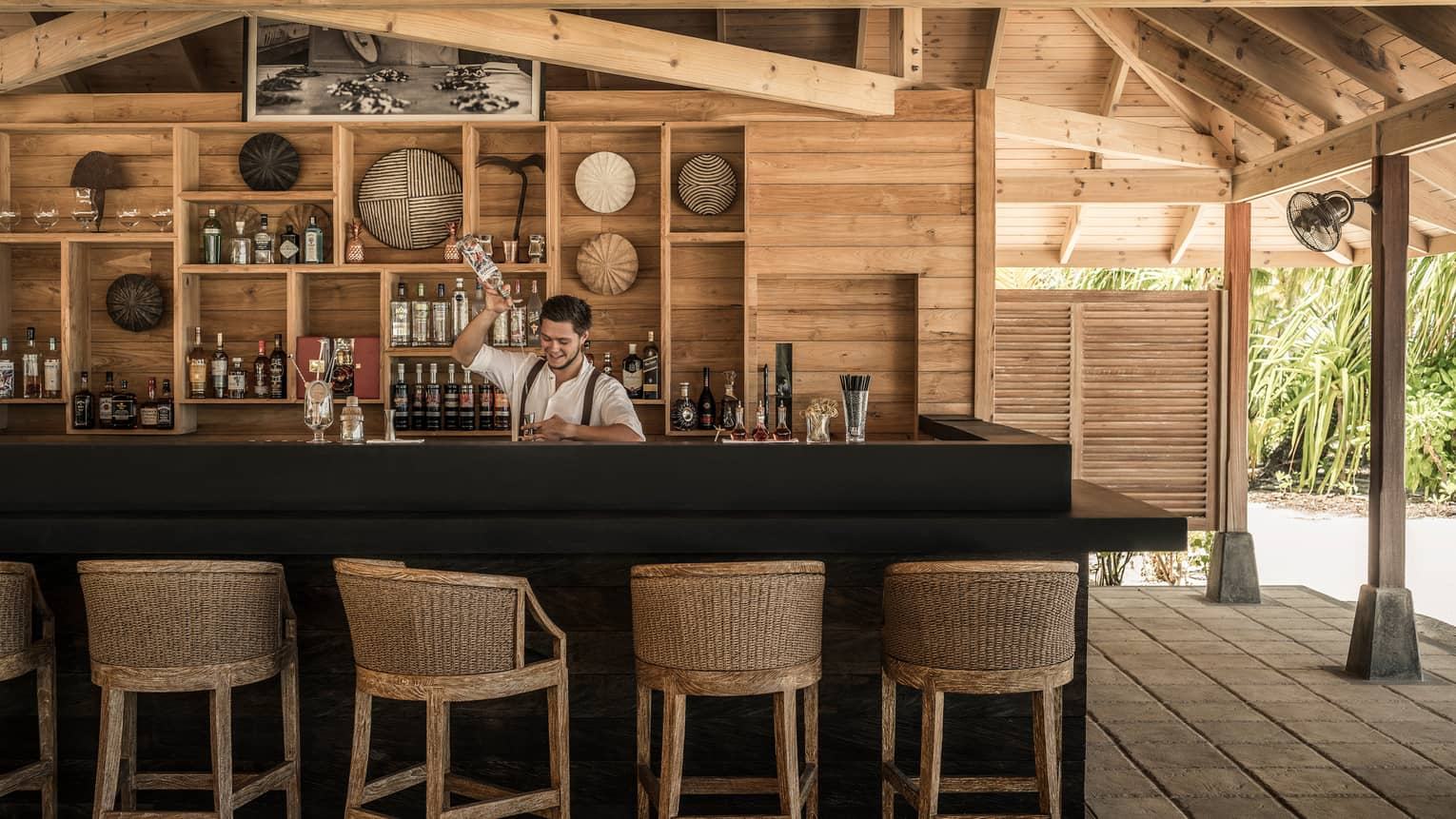 Beach Bar with wood-accented ceiling and walls