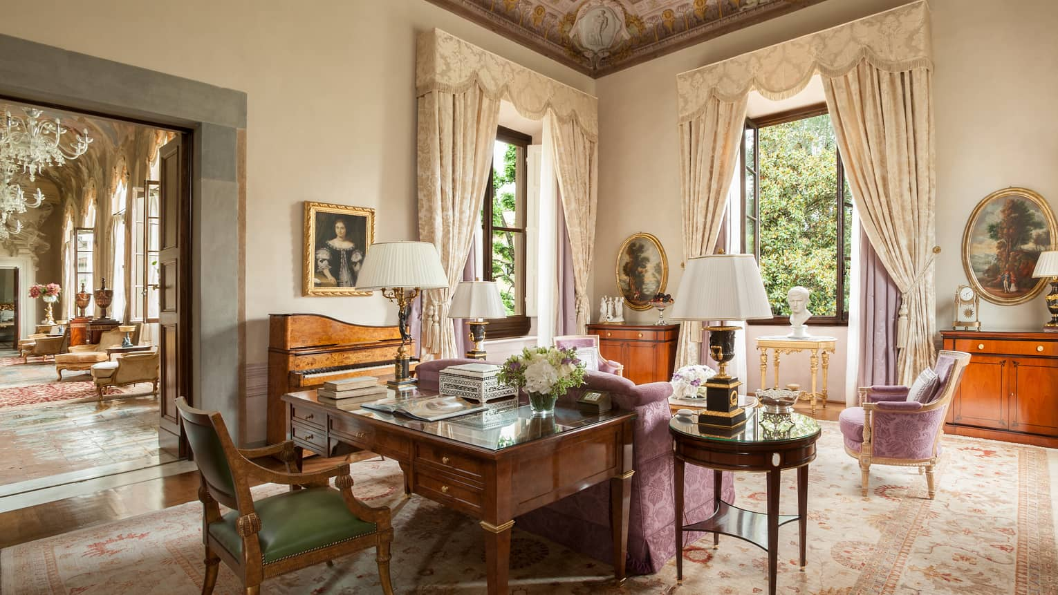 Royal Suite large wood work desk, pink silk sofa and chairs, tall windows under vaulted ceilings