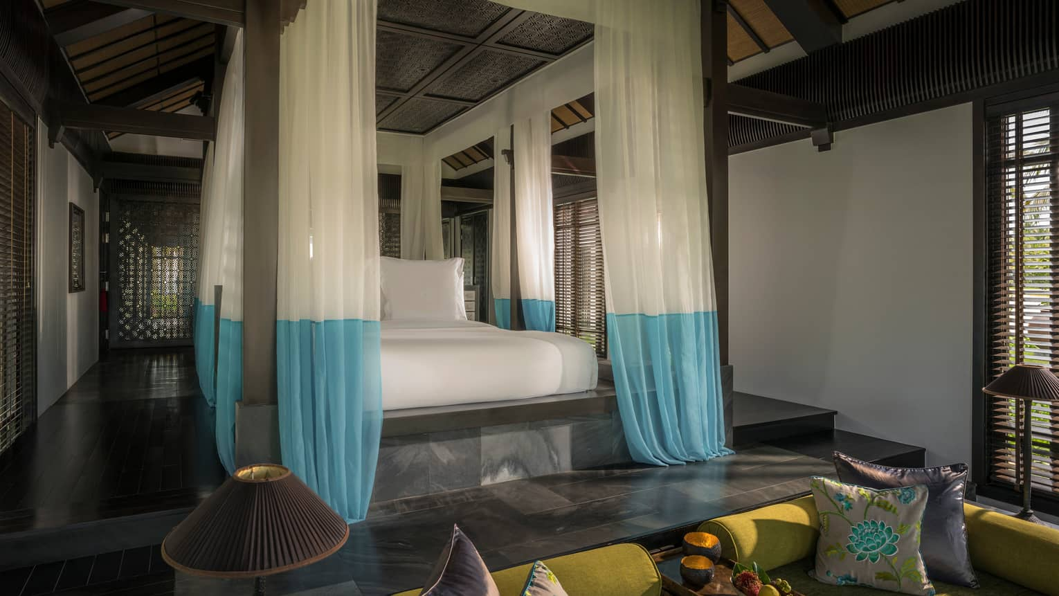 Villa raised platform poster bed with white-and-blue gossamer drape canopy