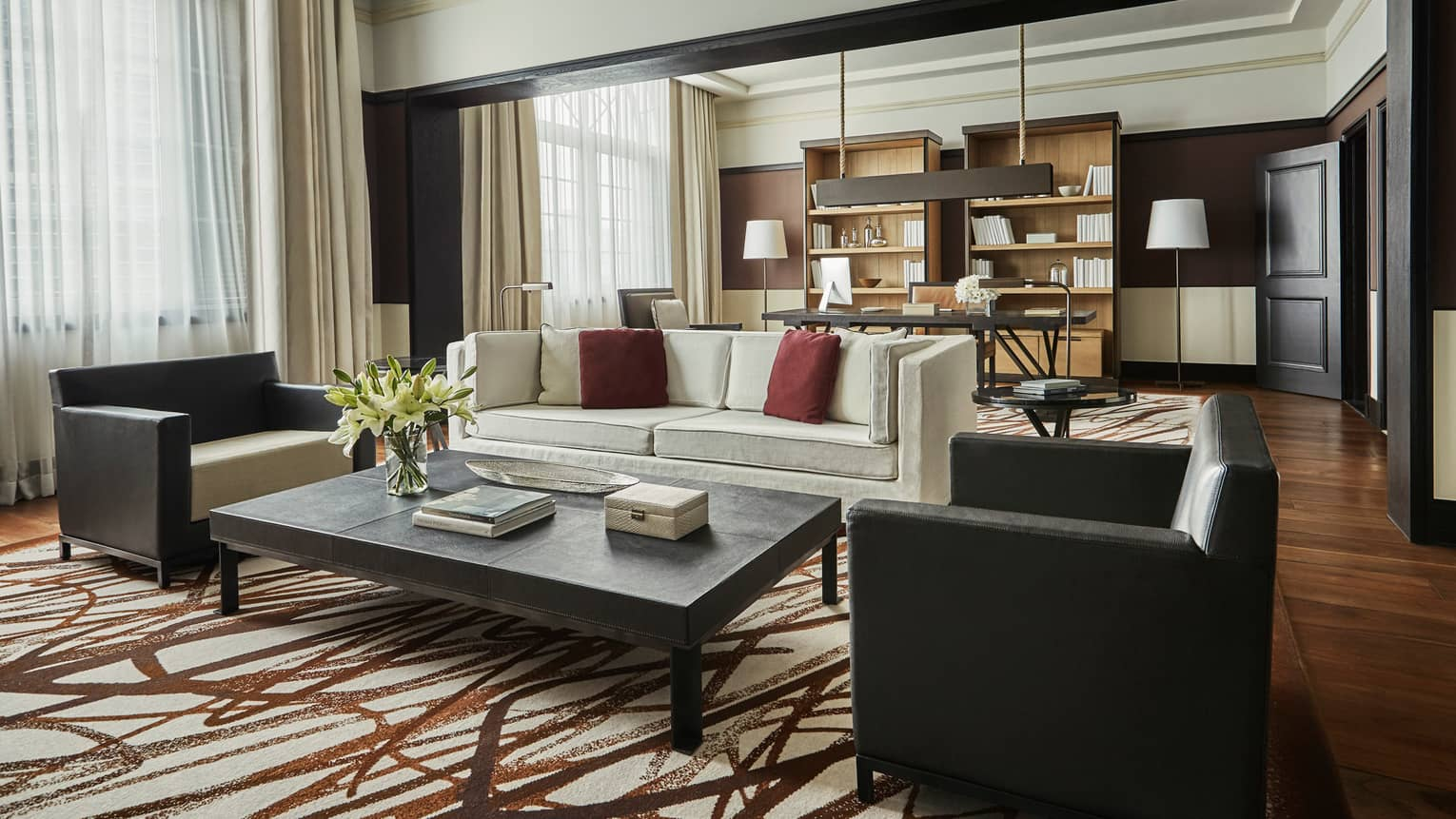 Bright Governor Suite sofa and two armchairs by coffee table, brown-and-white rug