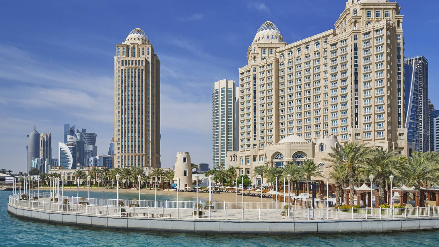 Four Seasons Doha hotel high rise building exterior, beach and palm trees