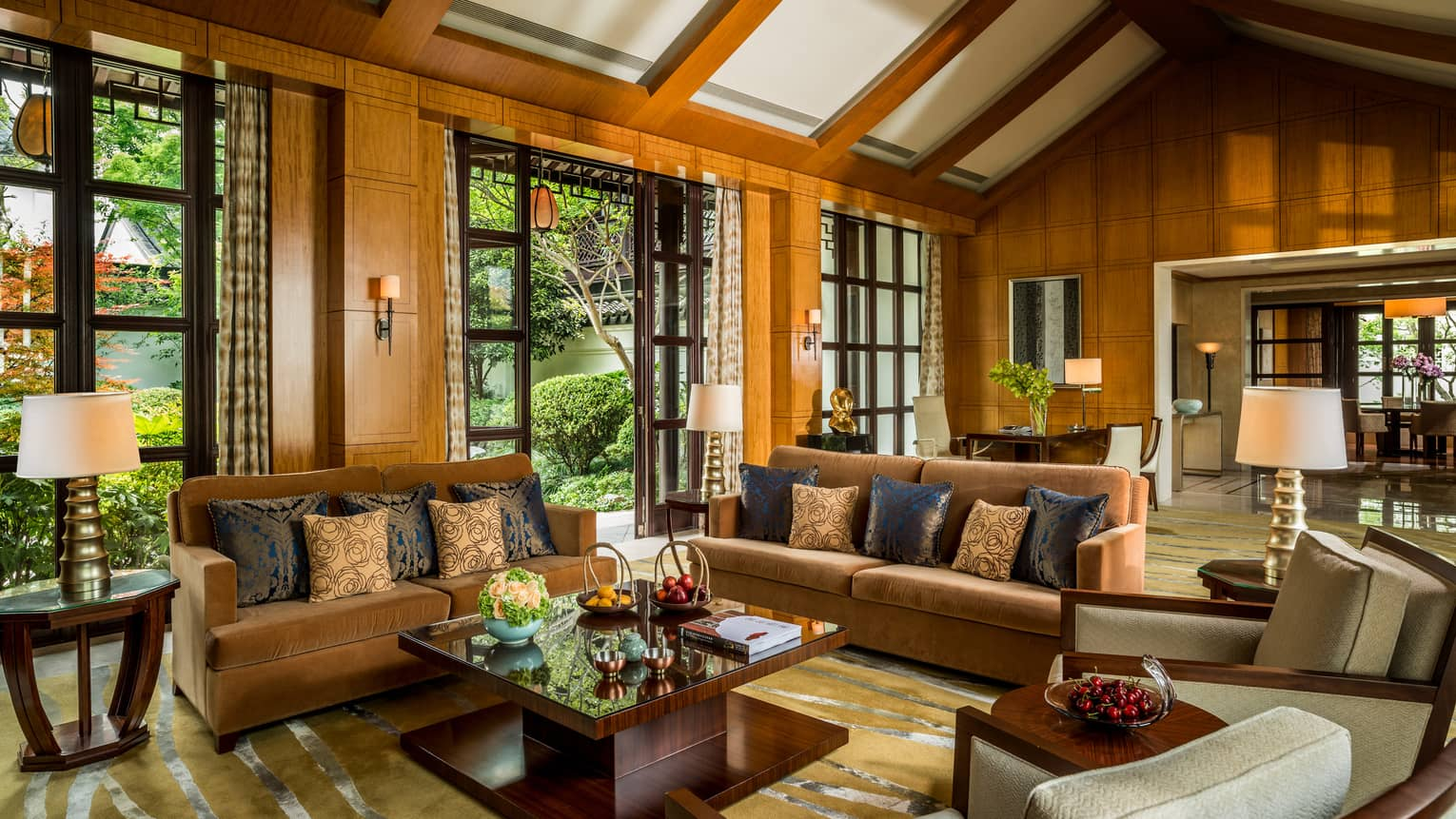 Presidential Villa with two orange velvet sofas, chairs around modern wood table