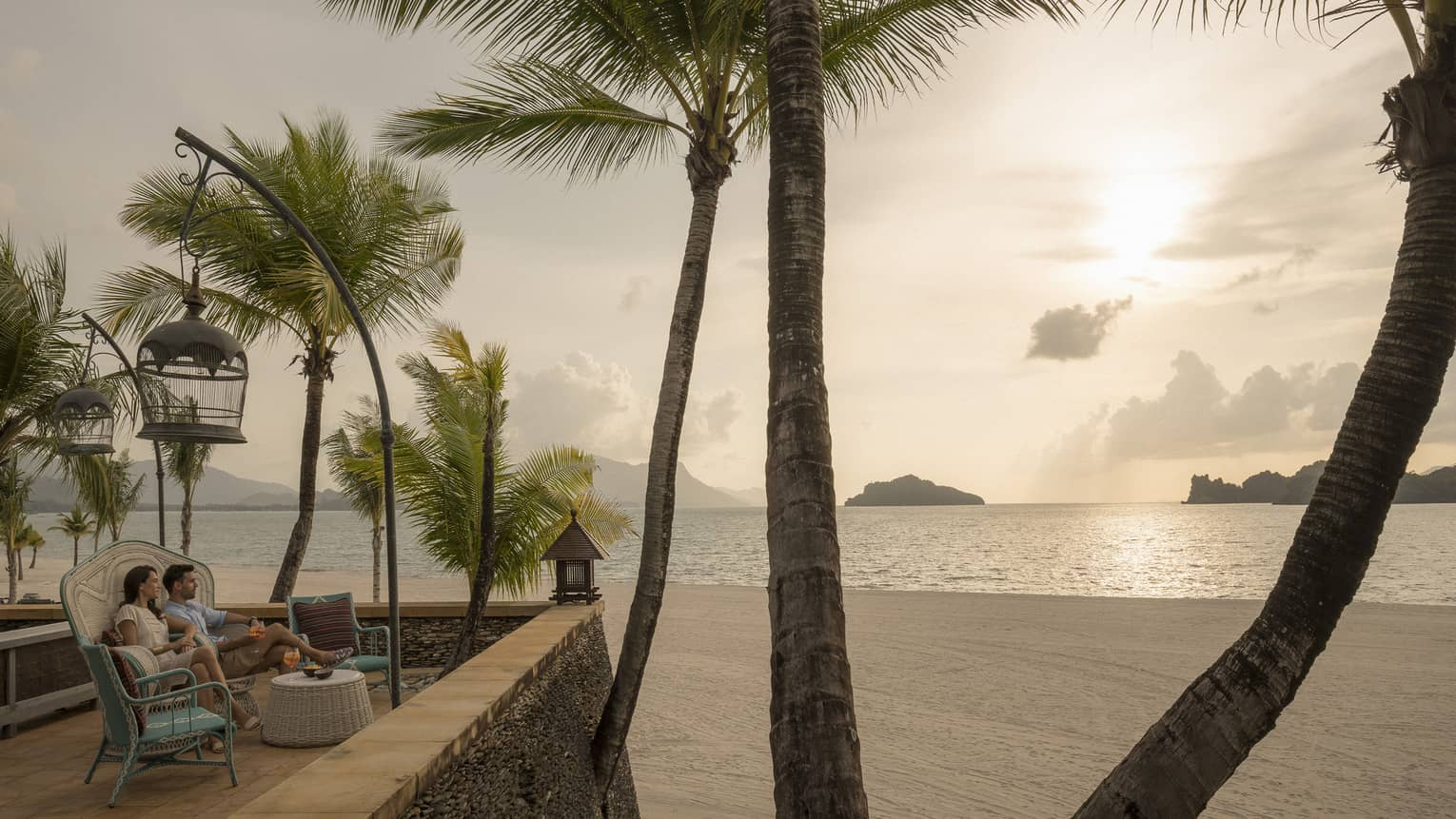 Upper Serai Sunset Lounge terrace overlooking the beach with view of palm trees