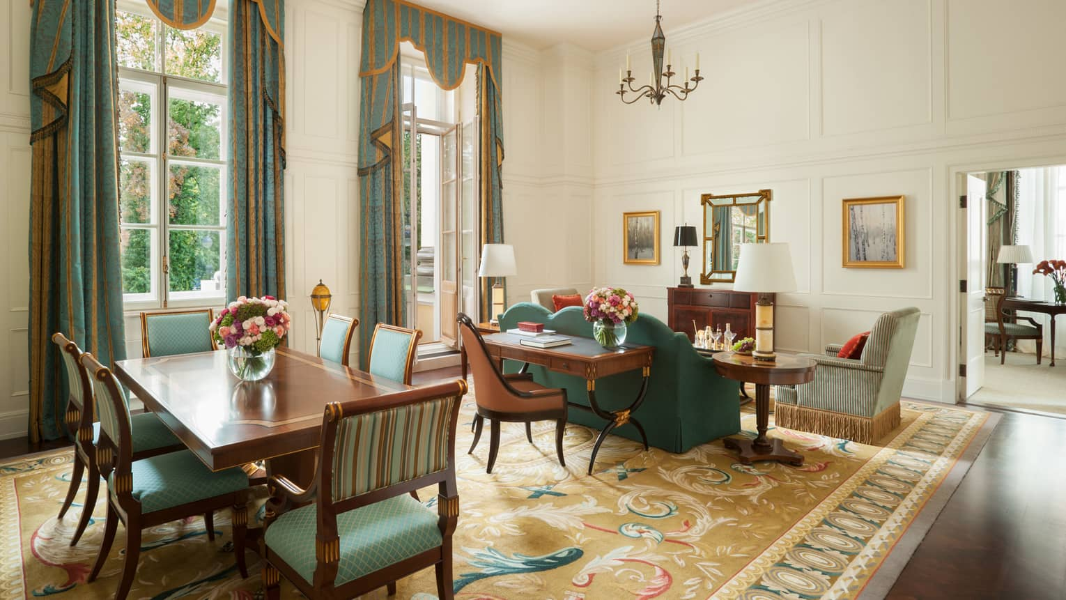 Admiralty One-Bedroom Suite large dining table and chairs by sitting area, teal green and gold decor